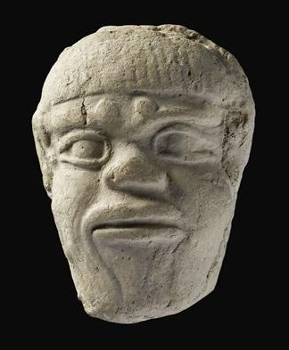 "Mask of the demon Humbaba, whose ""mouth is fire and breath death."" Images of this figure were used as lucky charms."